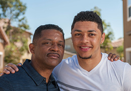 African American father and his adult son.